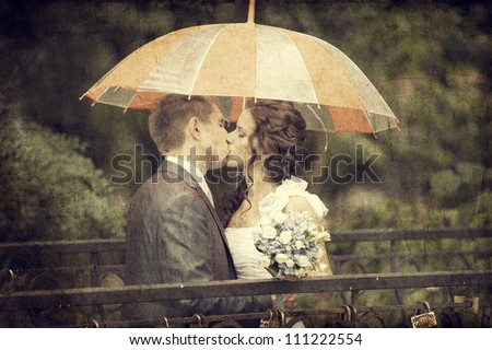Young couple groom and bride kissing. - stock photo