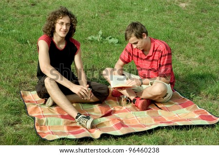 young couple has a picnic - stock photo