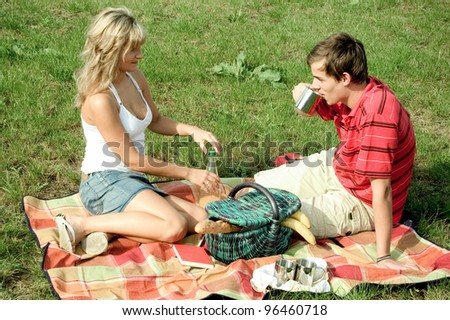 young couple has a picnic