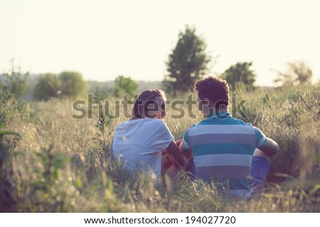 Young couple have romantic date at sunset - stock photo
