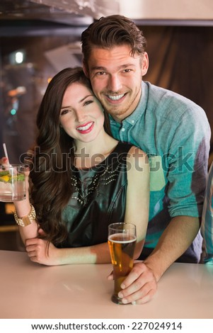 Young couple having a drink together at the bar