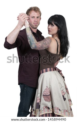Young couple having a fun time dancing together