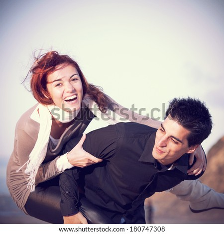 Young couple having a good time together - stock photo