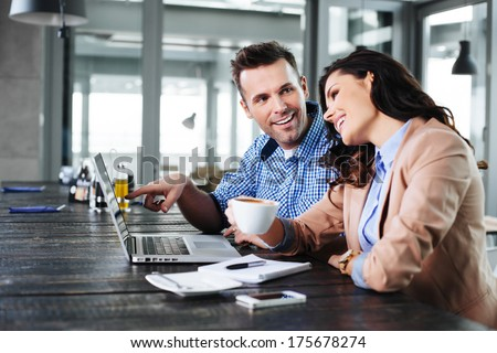Young couple having a nice time in front of  the laptop - stock photo
