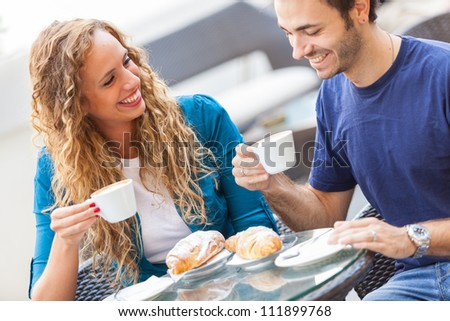 Young Couple Having a Traditional Italian Breakfast - stock photo