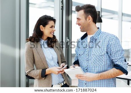 Young couple having a witty conversation in an office - stock photo