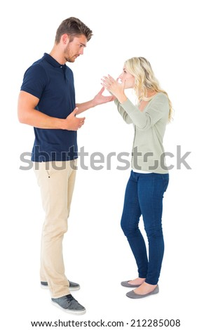 Young couple having an argument on white background - stock photo
