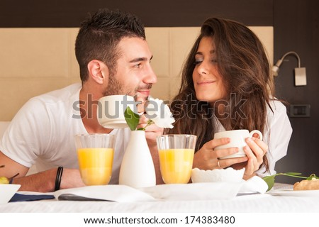 Young couple having breakfast in luxury hotel room.  - stock photo
