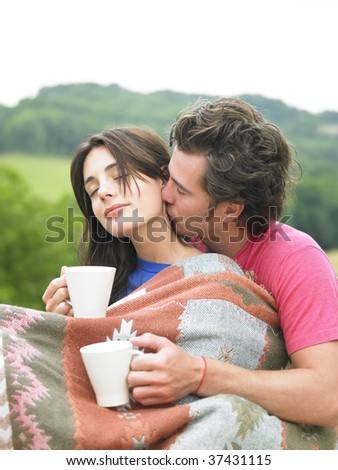 Young couple having coffee - stock photo
