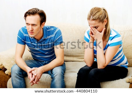 Young couple having conflict at home - stock photo