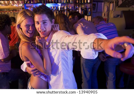 Young couple having fun at a nightclub - stock photo
