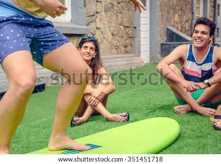 Young couple having fun in a summer surf class outdoors. Holidays leisure concept. - stock photo