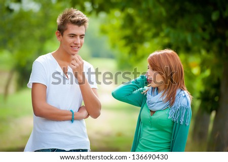 young couple having fun in the park,Italy - stock photo