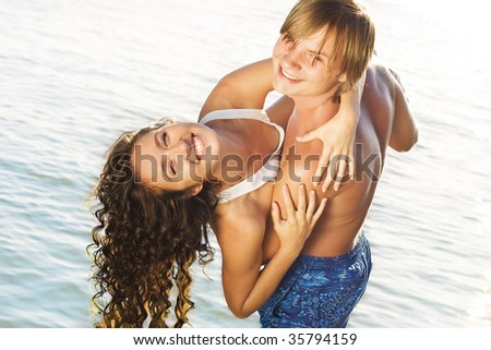 Young couple having fun in the water.