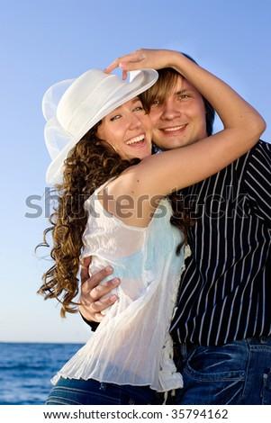 Young couple having fun near sea. - stock photo
