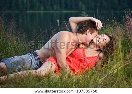 Young couple having fun on the shore - stock photo