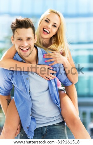 Young couple having fun outdoors  - stock photo