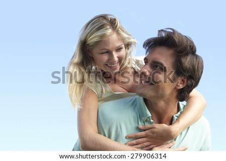 Young Couple Having Fun Outside - stock photo