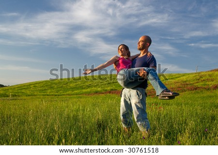 Young couple having good time on a beautiful springfield