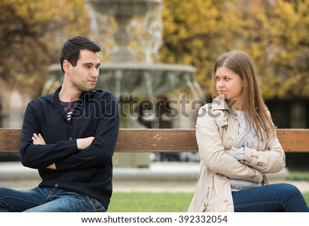 young couple having love fight on the bench in park in Paris, France - stock photo