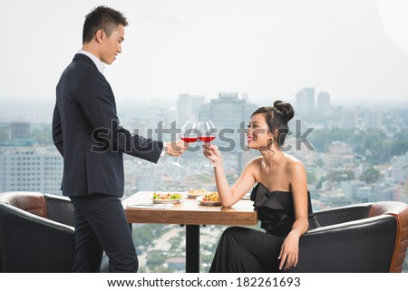 Young couple having luxury romantic date at a restaurant