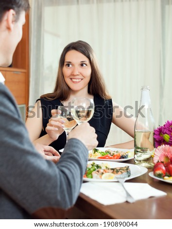Young couple having romantic dinner and drinking champagne in home   - stock photo