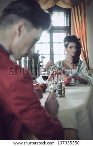 Young couple having strange breakfast - stock photo