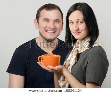 young couple having tea together