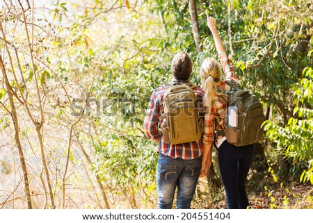 young couple hiking in autumn mountain - stock photo