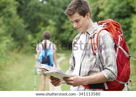 Young Couple Hiking In Countryside - stock photo