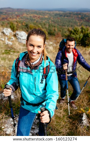 Young couple hiking in nature. - stock photo