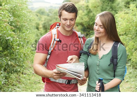 Young Couple Hiking In The Countryside - stock photo