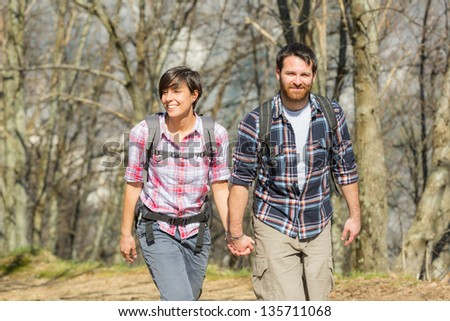 Young Couple Hiking in the Nature - stock photo
