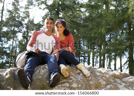 Young Couple Hiking Through Countryside - stock photo