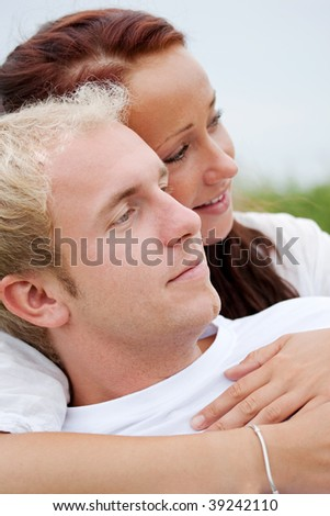 young couple holding and hugging romantically - stock photo