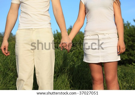 young couple holding hands each other
