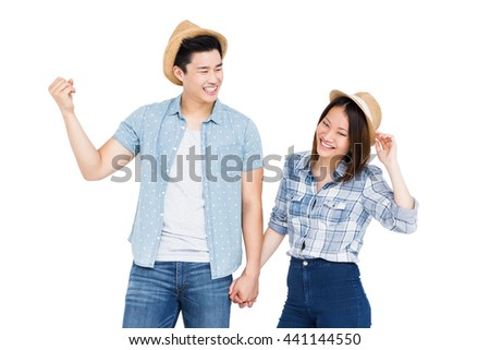 Young couple holding hands on white background - stock photo