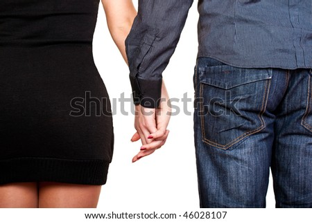 young couple holding hands - view from back