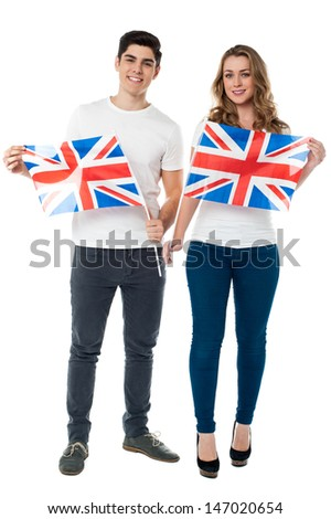 Young couple holding UK flag with pride - stock photo