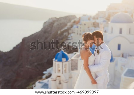 young couple honeymoon on the most romantic island Santorini, Gr