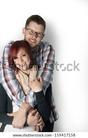 Young couple hugging each other - stock photo