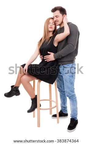 Young couple hugging in intimacy way on white background - stock photo