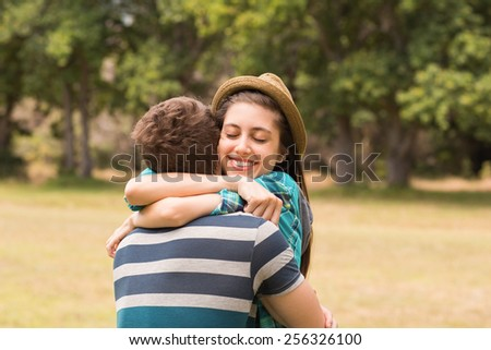Young couple hugging in the park on a sunny day - stock photo