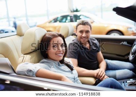 Young couple in a cabriolet - stock photo