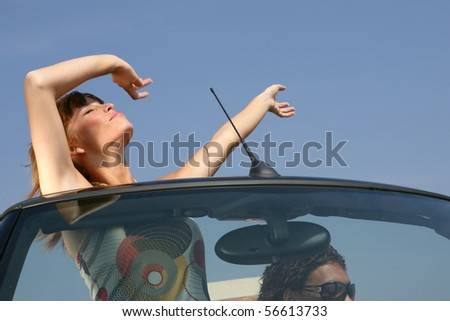 Young couple in a car - stock photo