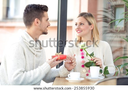 Young couple in a coffee shop on Valentine's Day - stock photo