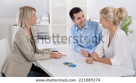 Young couple in a date with a banker or adviser for retirement arrangements. - stock photo