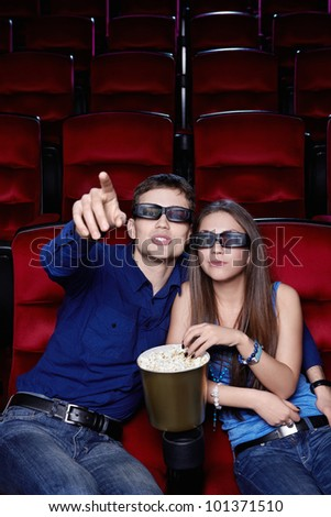 Young couple in a movie theater - stock photo