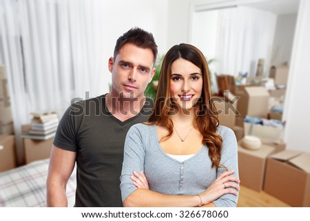 Young couple in a new house. Real estate and moving background.