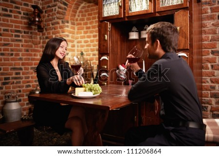 Young couple in a restaurant - stock photo